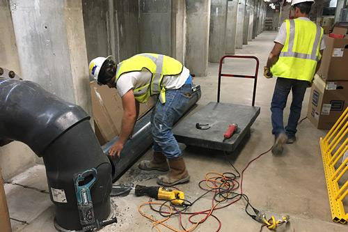 vendor resources photo of workers maintaining air system